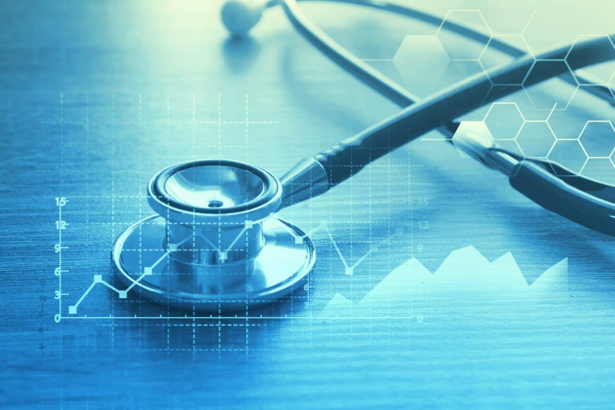 Medical stethoscope with a data graph and blue background